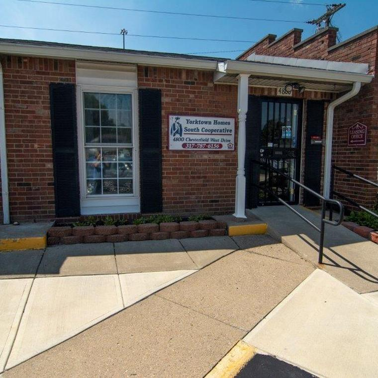 Brick leasing office entrace with handicap accessible ramp